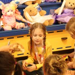 Build-a-Bear provides a host who walks the girls through each station and helps to keep them on budget.