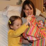 Opening gifts from Mommy's hospital bed