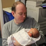 Daddy's first time holding Darcy Jane